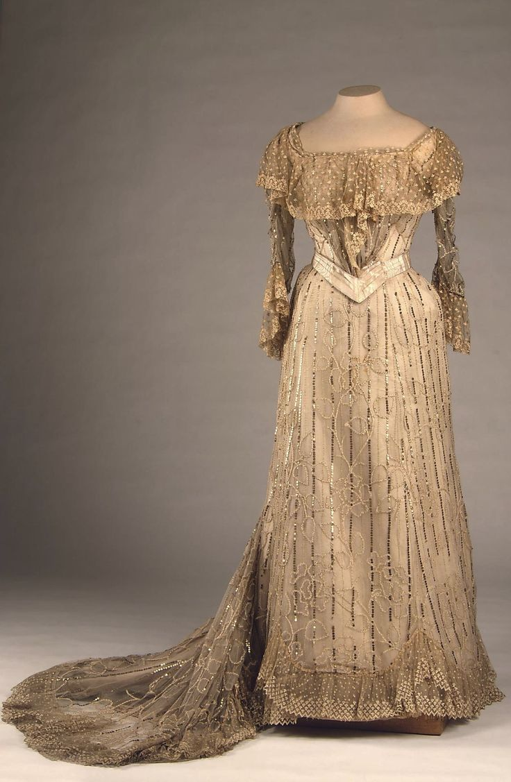 Evening Dress of Empress Alexandra Fyodorovna, by Auguste Brisac's Workshop, St. Petersburg, early 20th century, at the State Hermitage Museum. Silk thread, glass beads, spangles, tulle, satin and lace.