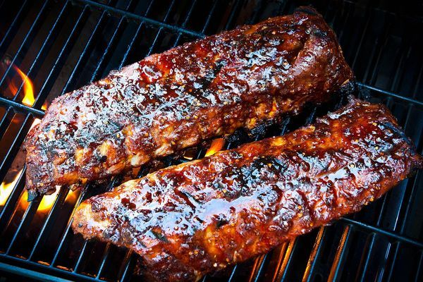 Grilling pork spare ribs on the grill