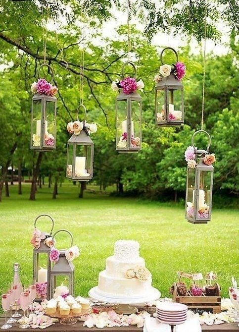 The hanging candles with the flowers...so pretty. The candle holders you can probably get so cheap at pat cantans or something