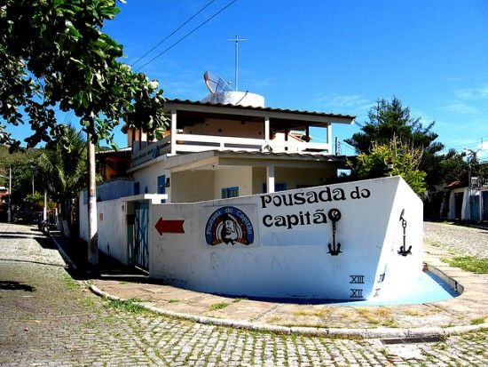 """This ship house, called """"Pousada do Capitao"""" (or """"Captain's Lodge""""), in Rio de Janeiro's very scenic Arraial do Cabo Bay, is actually a small hotel. As indicated by its exterior, the hotel's theme is nautical through and through — from its sextants and life buoys right down to its beach-themed sheets and towels. Fishing can be arranged."""