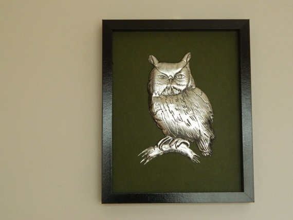 Metal Sculpture of A 3d pewter embossed Barn Owl on a dark green mount board in a plain black frame to accentuate the antique-silver look of the pewter.     Ideal gift for a man for his office or his study at home. Get one for dad for Fathers Day !    The high relief areas are filled from the back to prevent them from denting
