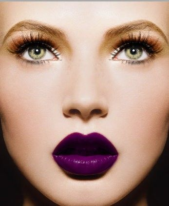 Dramatic lashes, warm neutral shadow and deep violet lip