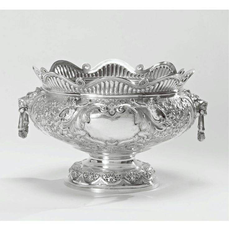 "A Victorian silver ""Armada pattern'' punch bowl, Sheffield, 1897."