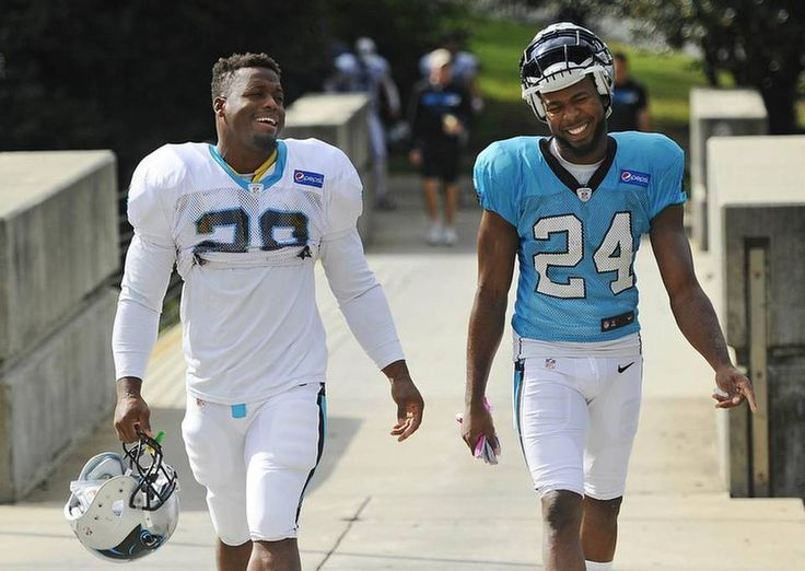 Carolina Panthers' Jonathan Stewart (28) and Josh Norman (24) walk to the team's practice facility on Tuesday, October 13, 2015.