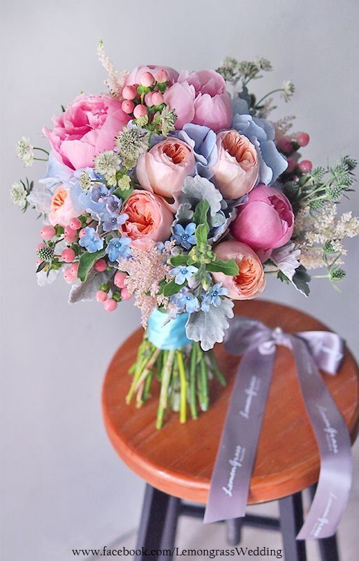 Garden rose, peonies with a mix of hydrangea and astibles as well as other fillers.