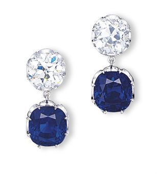 AN EXQUISITE PAIR OF SAPPHIRE AND DIAMOND EARRINGS  Each set with a cushion shaped sapphire weighing 8.74 and 8.65 carats, to the old mine-cut diamond surmounts, mounted in platinum, 2.8 cm long. Price Realized $2,041,948 USD
