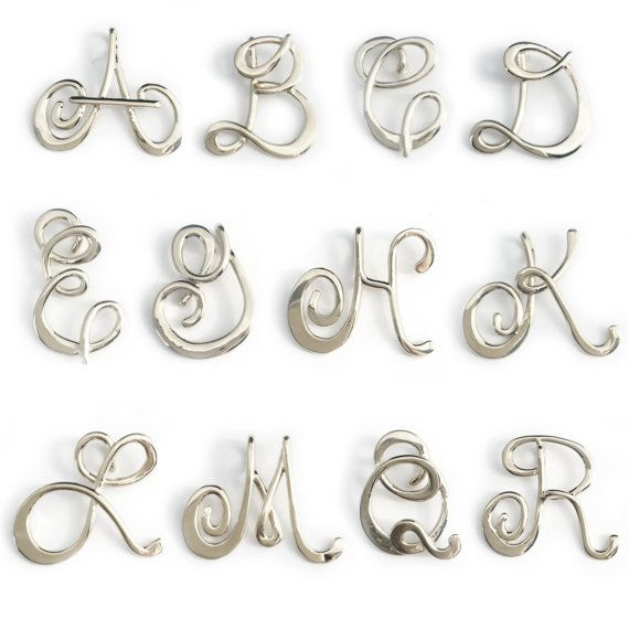 Sterling Silver initial pendant.  Each letter measures 1 1/4 inches and comes with a 16, 18, 20 or 24 inch chain.  Last photo shows size