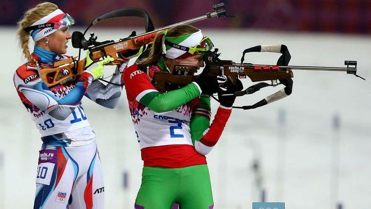 Darya Domracheva (R) of Belarus shoots next to Czech Republic's Gabriela Soukalova in the Women's 12.5km Mass Start Biathlon. Sochi 2014