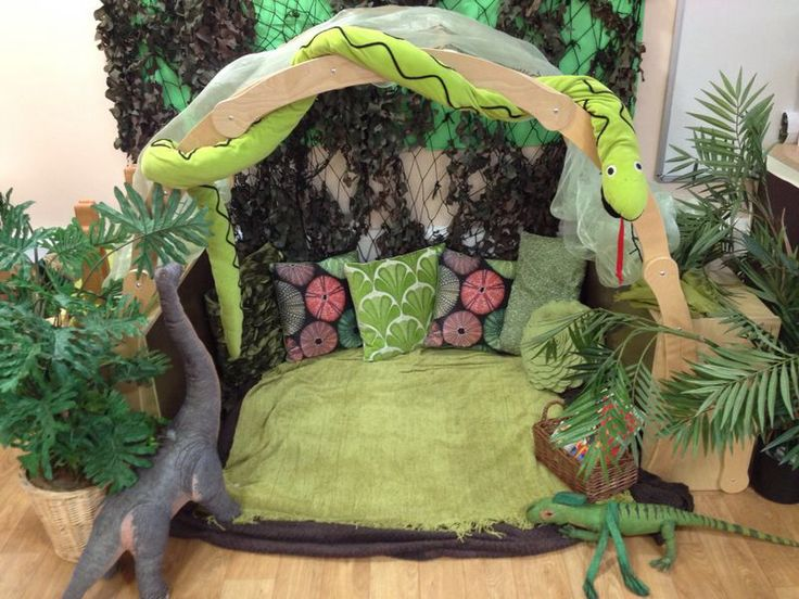Dinosaur communication friendly space. Lots of cushions, blankets, books and toys in a quiet space in the classroom.