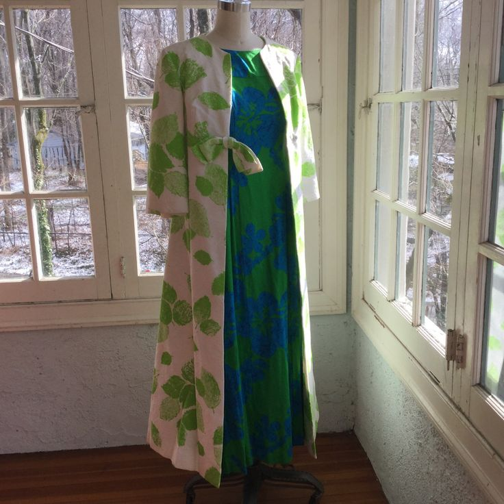Matching up a 1960s maxi coat with a 1960s Hawaiian Maxi dress from my shop...one of my current challenges is to marry long coats that look great with long dresses from the same era.