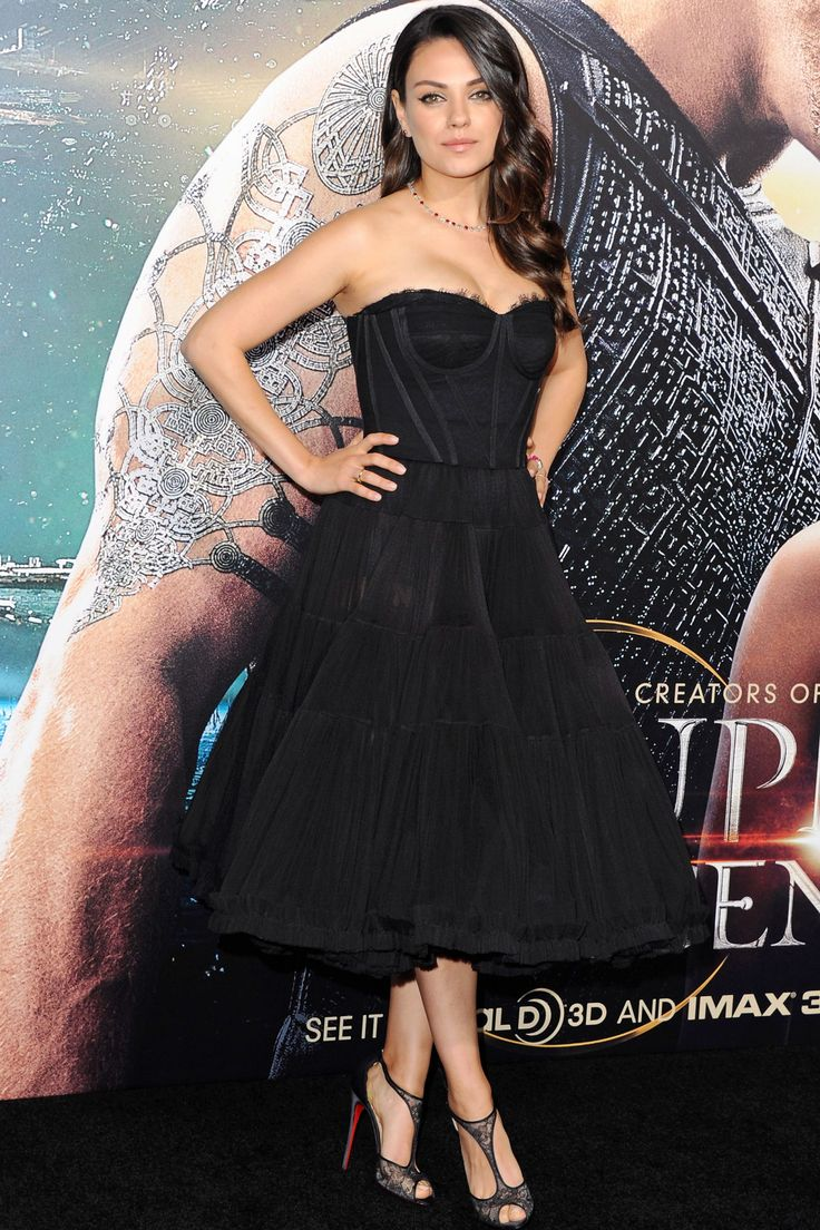 PERFECTION - Mila Kunis madeher first red carpet appearance since giving birth to daughter Wyatt, attending the premiere of Jupiter Ascending in Dolce & Gabbana on February 2.   - HarpersBAZAAR.com
