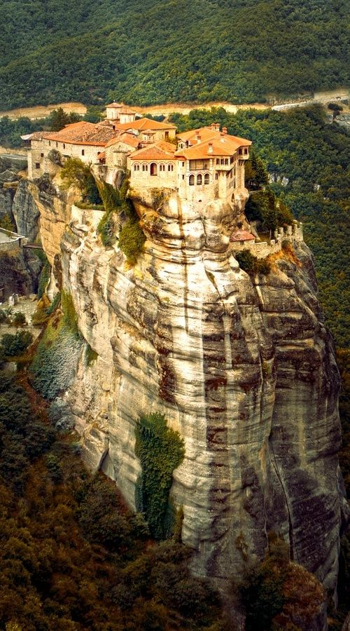 Check out the incredible Meteora Monastery in Greece, perched thousands of feet aloft atop a steep cliff face #travel #amazingplaces #destinations