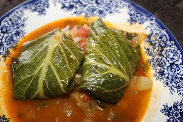 Golubtsy collard greens leaves grits creole sauce