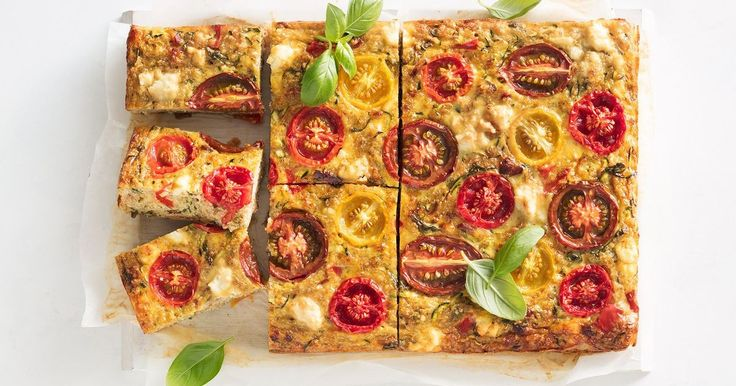 For a healthy dinner or a hearty snack, try this delicious quinoa slice, filled with zucchini, tomatoes, bacon and feta.