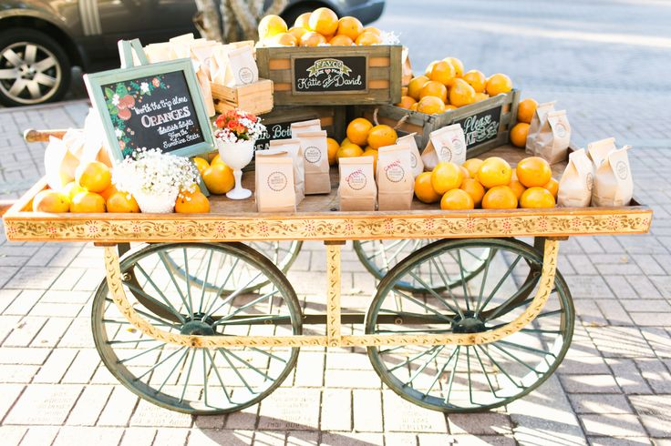 Peddlers Cart by Wish Vintage Rentals for favor display | Photography: Ben Sasso | Chalk Design: Chalk Shop | Videography: White In Revery | Floral Design: Velvet And Twine | Cake: The Sugar Suite | Invitations: Renee Nicole Design + Photography | Reception Venue: Winter Park Farmers Market | Catering: Arthur's | Day Of Coordination: Sweet Pea Events  Vintage, Orange, Old-Florida Inspired Wedding