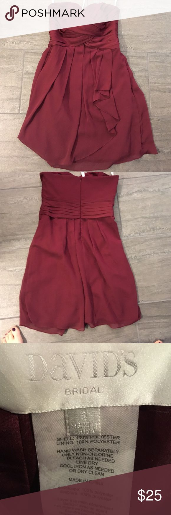 David's Bridal Short Crinkle Chiffon Dress Wine colored Davids Bridal Bridesmaid dress size 8. Worn once. The little class on the back that gives an extra clasp that is near the zipper to give extra security is loose & needs a stitch in it. Not required but nice to have if you are squeezing into it like I was just after having a baby. No malfunctions for me! Lol Davids Bridal Dresses Wedding