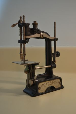 Rare 1901 Smith & Egge hand sewing machine in mint condition still in wooden box with all paperwork and clamp. This was originally bought at Miller and Rhodes in Richmond, Virginia