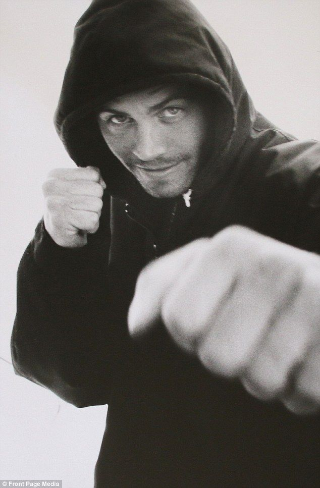 Rough & tumble: This photo of Paul Walker shadow boxing was  taken by the late actor's goo...