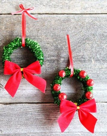 It's hard to believe shower curtain rings are what these wreaths are made of. Top them off with red ornaments to match their bow.