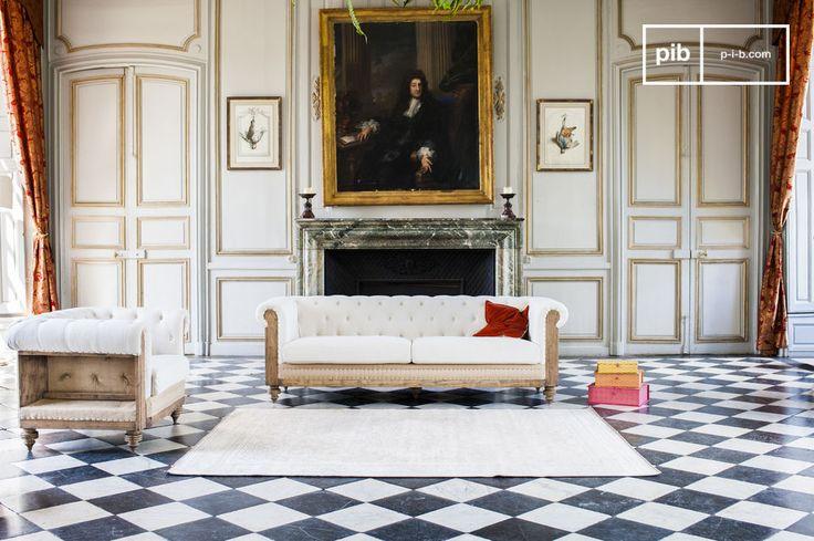 El sofá Chesterfield es un sofá vintage del estilo Shabby Chic. Aquí se ve bonito dentro de un salón enorme, pero se verá así también dentro de un interior Shabby Chic más pequeño.