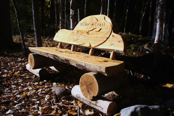 Mike's Bench Solid White Cedar bench with a lightly carved Northern Pike