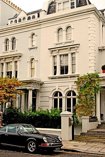 Beautiful home in London With A Classic Car Parked in Front