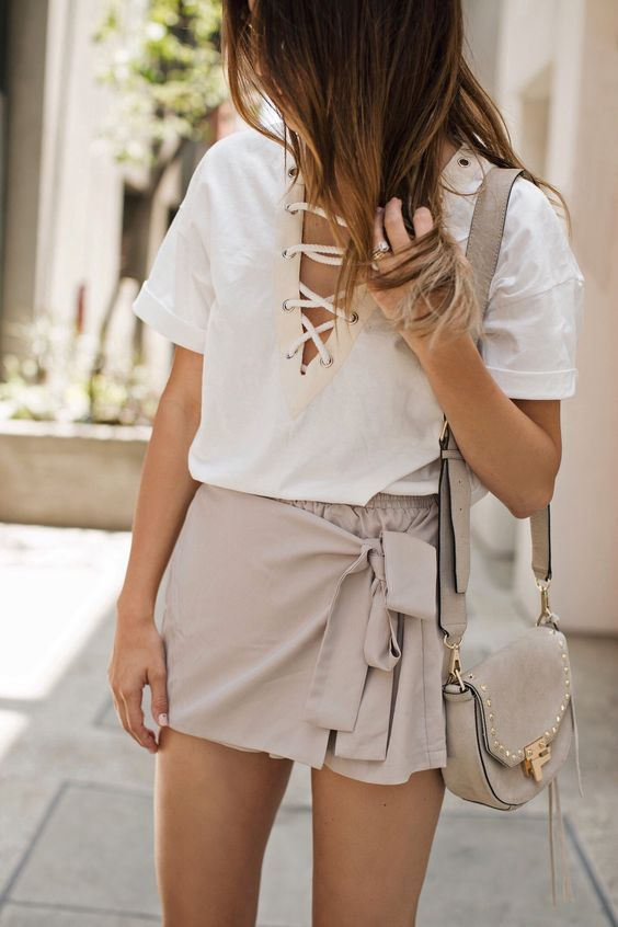 Pair a lace up top with a cute skirt this spring. Let Daily Dress Me help you find the perfect outfit for whatever the weather! dailydressme.com/