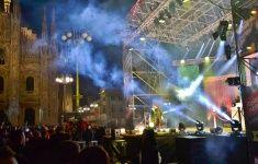 Nadia Mikushova. Italian popular rapper Caparezza is singing in Milan Duomo square. stock photo