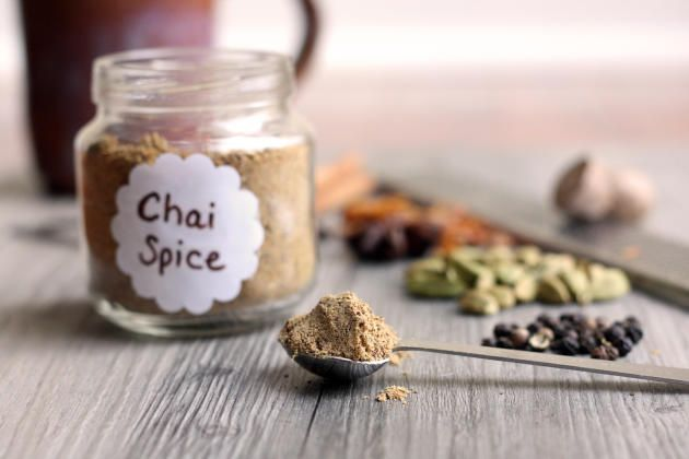 Chai Spice Mix Recipe Beverages with green cardamom pods, black peppercorns, cinnamon sticks, star anise, mace, clove, nutmeg, ground ginger