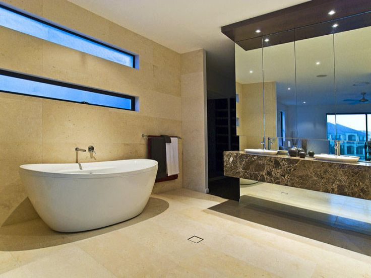 beige, greys, freestanding bath, mirrored cabinets, long windows, travertine, brown marble counter, under counter mirrors