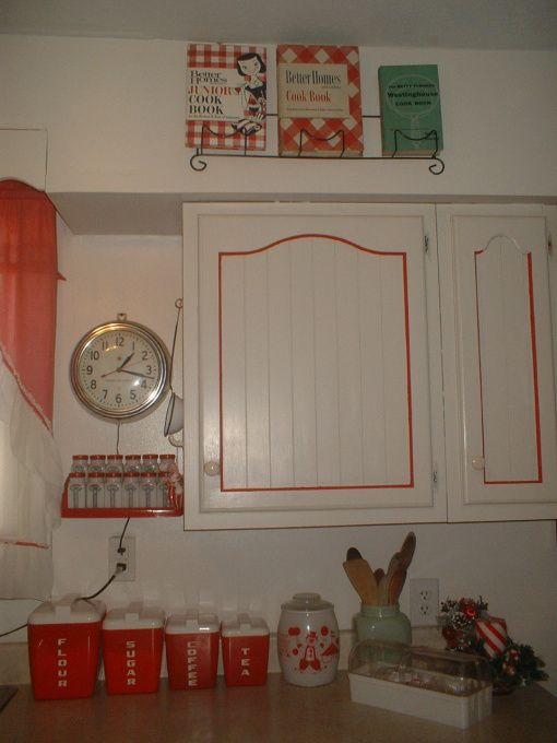 Retro 50s Vintage Red & White Kitchen. Love the small detail of trimming out the upper kitchen doors in red...