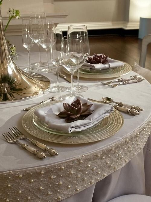 elegant table setting. Love the trim around the edge of the table.