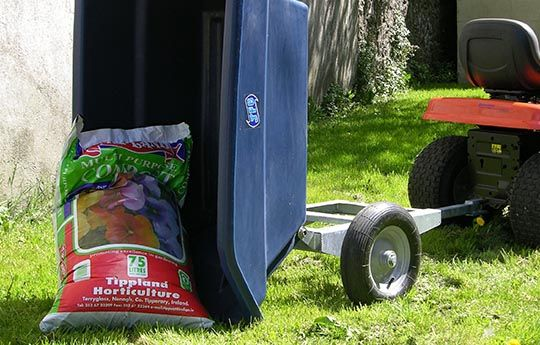 ATV 250 litres trailer showing tipping load. Suitable for ATV quad bikes, compact tractors, ride-on lawn mowers and UTVs. For more info contact us at http://www.fresh-group.com/trailers-trolleys-and-carts.html