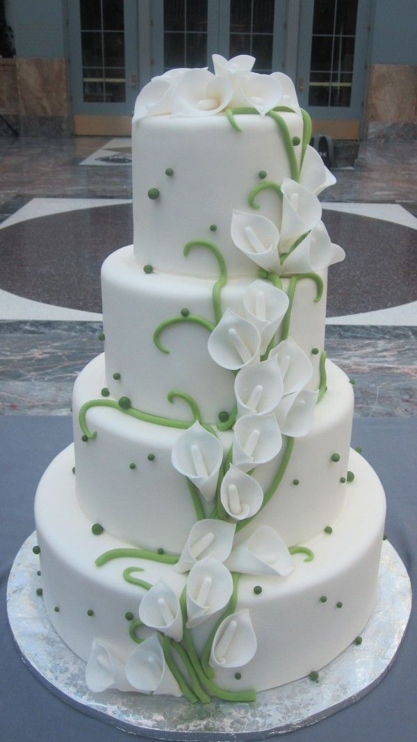 Simple and Elegent cake! As amazing as all the other cakes have been, the hint of green with the beauty of the calla lily along with the simplicity of the cake would make this my choice of cakes for a renewing of vows!