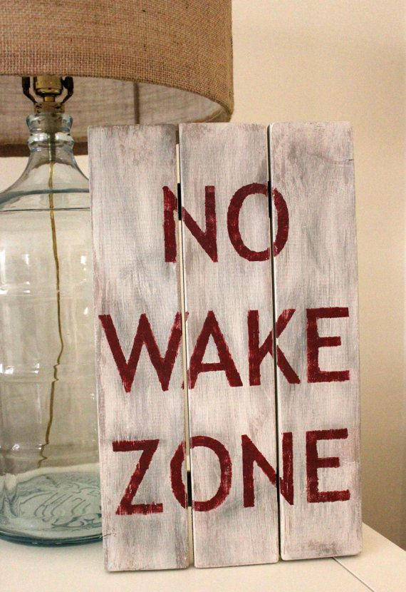 Hand painted No Wake Zone wooden sign.  Put it right next to the alarm clock.  Ha!