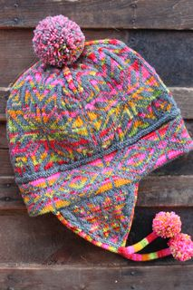 You need 1 ball of Koigu and 1 ball of superwash wool to make the hat only. If you want to make the pom poms in Koigu then you may need an extra skein.