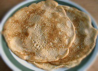 Blini is a tasty Russian pancake. It is folded to fill with a filling of your choice. It is a famous