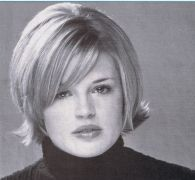 Blonde short bob haircut with long layers and bent ends, a side part with side swept bangs hairstyle