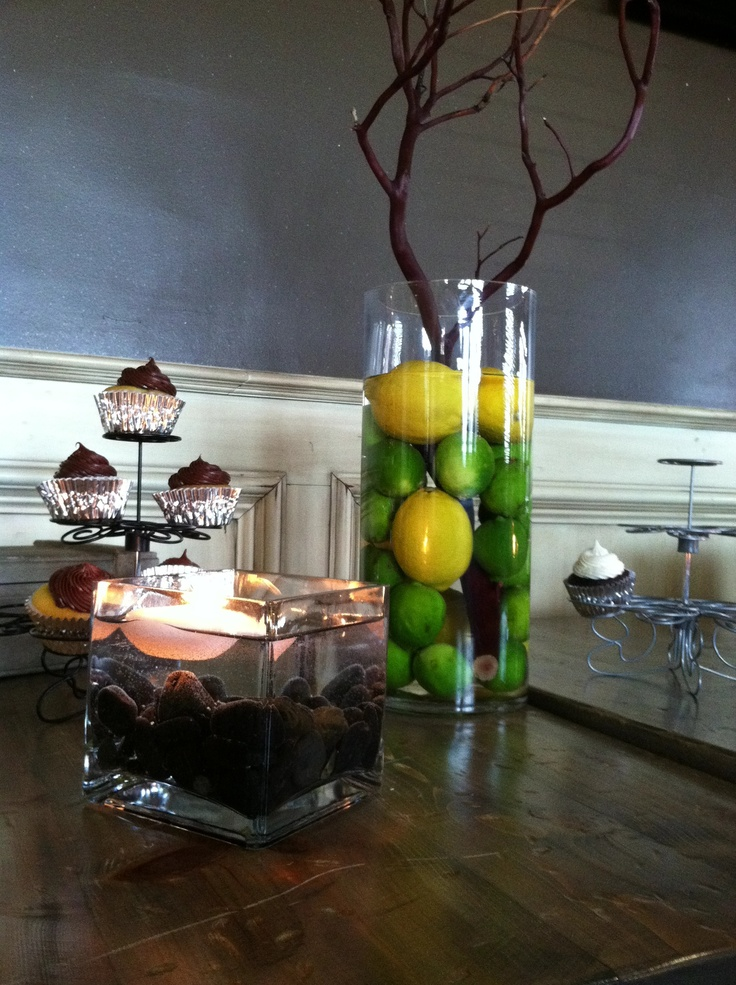 Lemon lime centerpiece with branches and vase river