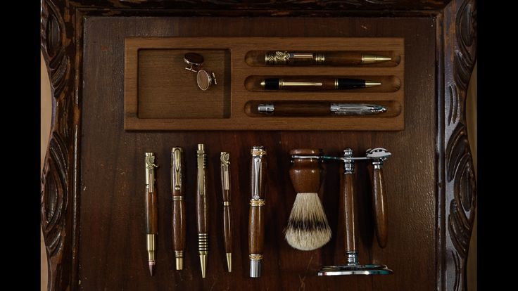 Pens, cufflinks, shaving supplies, and pen rests made with wood from the USS North Carolina and USS New Jersey Decking