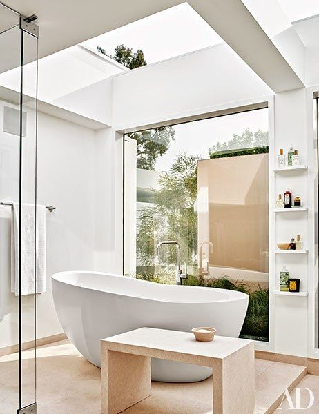 A retractable glass roof crowns the master bathroom   archdigest.com