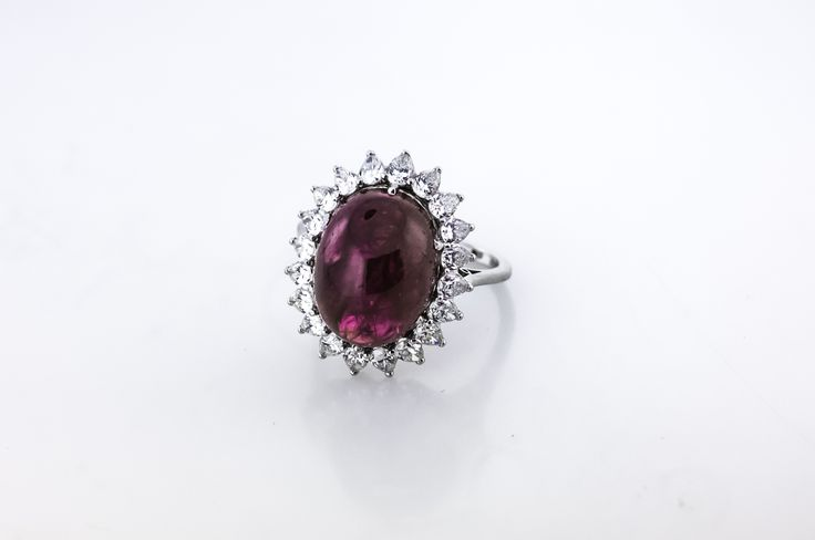 Luscious 8 carat ruby in platinum and accented by pear shaped diamonds.