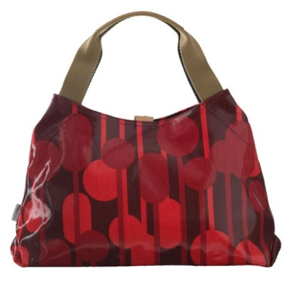 Orla Kiely Purse Tan canvas shoulder straps. Red patent leather print bag. Several small pockets on inside.  Snap closure. Interior photos coming soon. Bag is pre-loved but in great condition. No Trades or PayPal Orla Kiely Bags