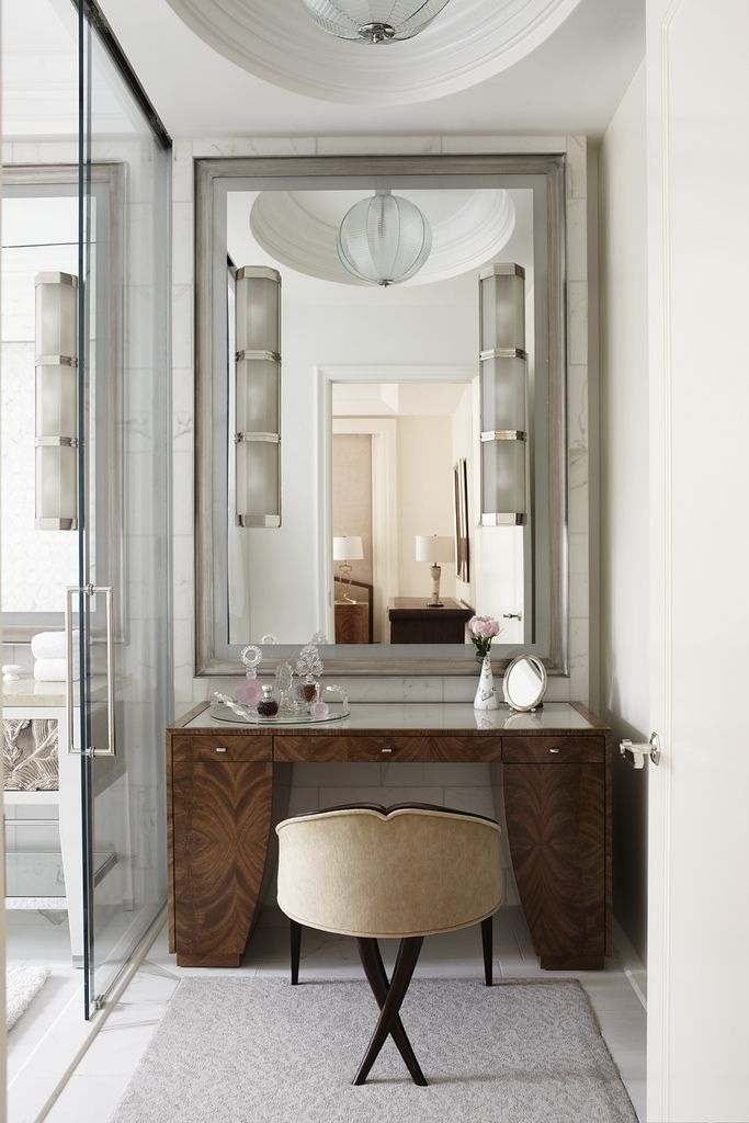 wood vanity, master bath, sconces mounted on mirror, glass door, carrara marble