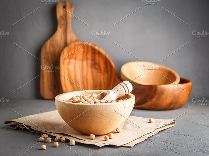 Chickpeas in a wooden bowl on gray background by Irrin0215 on @creativemarket
