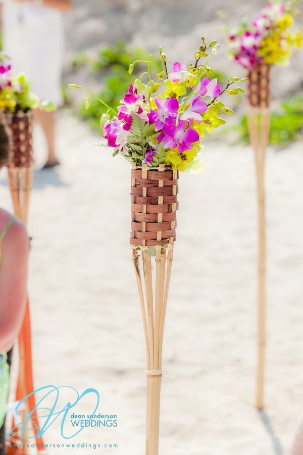 #fucsia and #green dendrobium orchids floral tiki torches #weddingcancun by #latinasia