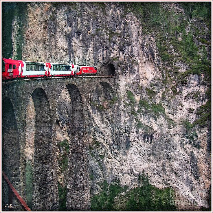 The Landwasser viaduct is a swiss railway over crossing on the Glacier-Express route. The viaduct is located in grisons and it belongs to the UNESCO World Heritage since 2008. The Glacier-Express is a panorama train, running from Zermatt to St. Moritz !  -  Photo by Hanny Heim, Snowbird Photography #switzerland #viaduct #glacierexpress #railway #train #bridge
