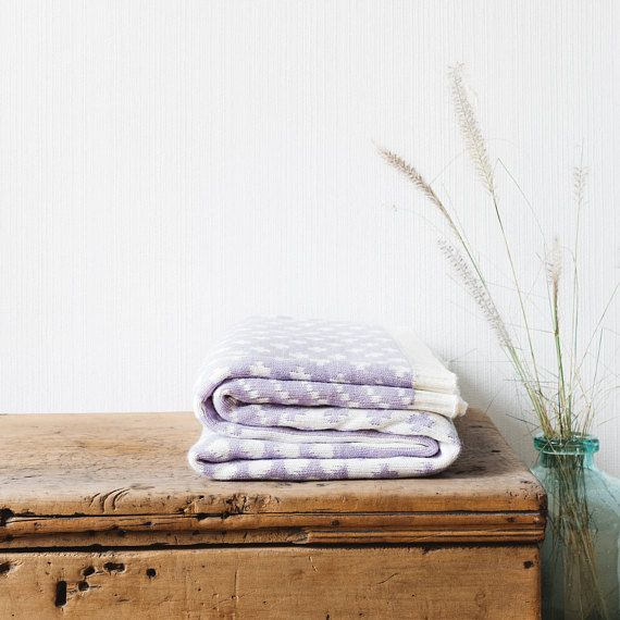 Snuggle up and enjoy with this everyday knitted wool blanket. This heavy and cozy blanket will keep you warm and happy. The oversize proportions mean there is plenty of room for two. Fully reversible, its modern designs make it ideal for the lounge room or bedroom. Use it over your bed, couch, sofa or chair for a warm and hip touch.  Size: W 180 x L 150 cm Material: Wool Blend, high performance fiber. Care instructions: Hand wash in neutral soap or Dry Clean. Do not use a dryer and dry flat…