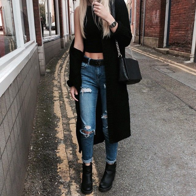 Black crop top, oversized coat, and ripped mom jeans.