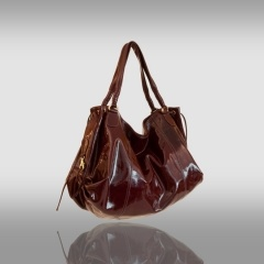 Olivia: was $330 but now is $83.81.    Two top handles on this very roomy tote, magnet closure, envelope details with italian gold hardware is irrestible.